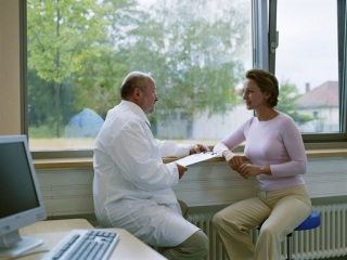 Woman talking with a doctor in an office