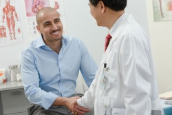 Man shaking hands with a doctor
