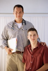 Doctor standing with teen boy