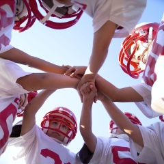 Young football team in huddle