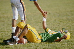 Football player lying on the field