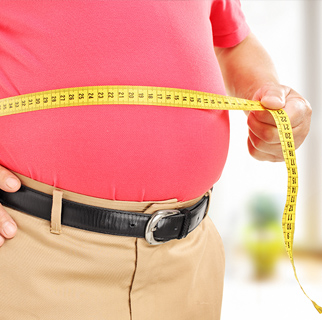 Close up image of a larger belly being measured with a measuring tape.
